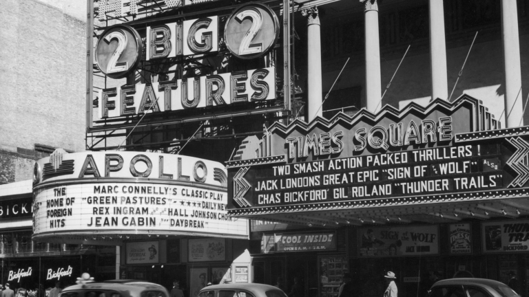 The Apollo and Times Square Theatres, circa 1941. Image: Getty.