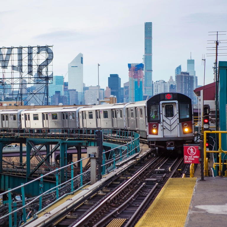 7 Train pulling into Queensboro Plaza. Photo by Tagger Yancey/NYC and Company.