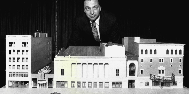 Douglas Durst stands behind a scare model of the Times Square Theatre and New Victory Theater. The Durst Organization would eventually build the first building as part of the 42nd Street Development Project, across the street at 4 Times Square. Image: Getty.