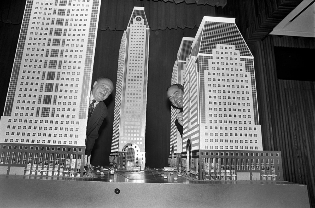 New York City Mayor Ed Koch and New York State Governor Mario Cuomo pose with scale replicas of the proposed four tower office development for 42nd Street and 7th Avenue. Some felt the uniformity of the buildings would change the character of the block. Credit: New York Times