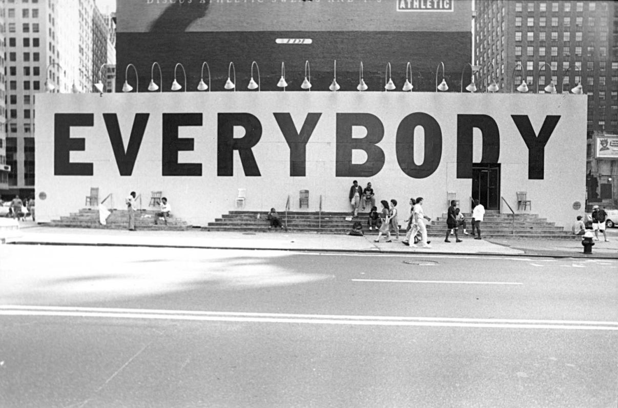 "The famous ""Everybody"" billboard, designed by Tibor Kalman, that the 42nd Street Development project commissioned with Creative Time to bring people back to the block once the stores and buildings had been condemned. Credit: Maggie Hopp for Creative Time"