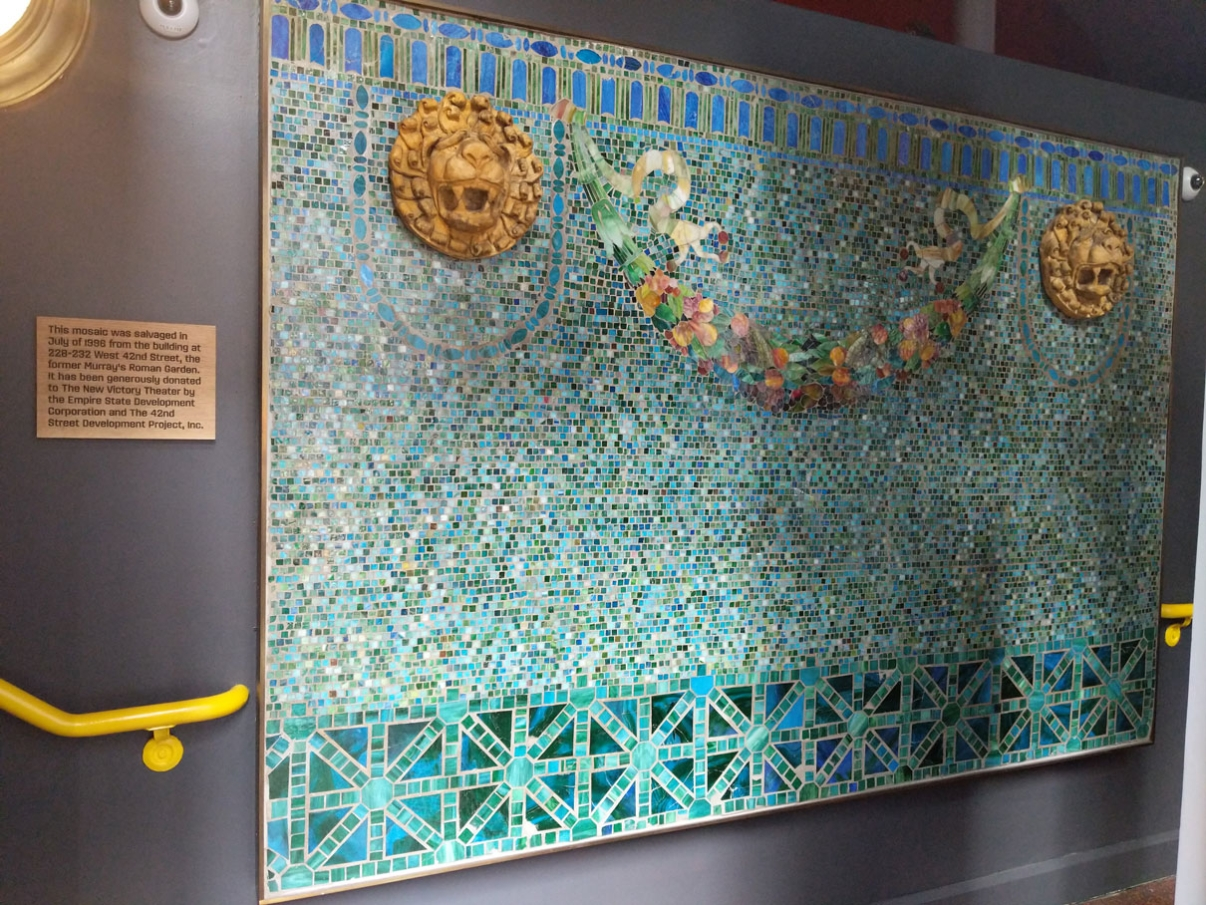 A glass mosaic from Murray's Roman Garden, now in the entryway of the New Victory Theater. Image: New Victory Theater